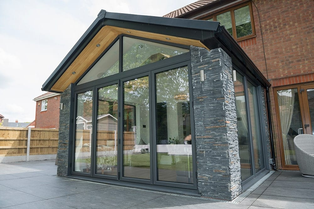 WARMroof stone decorative walls with black roof
