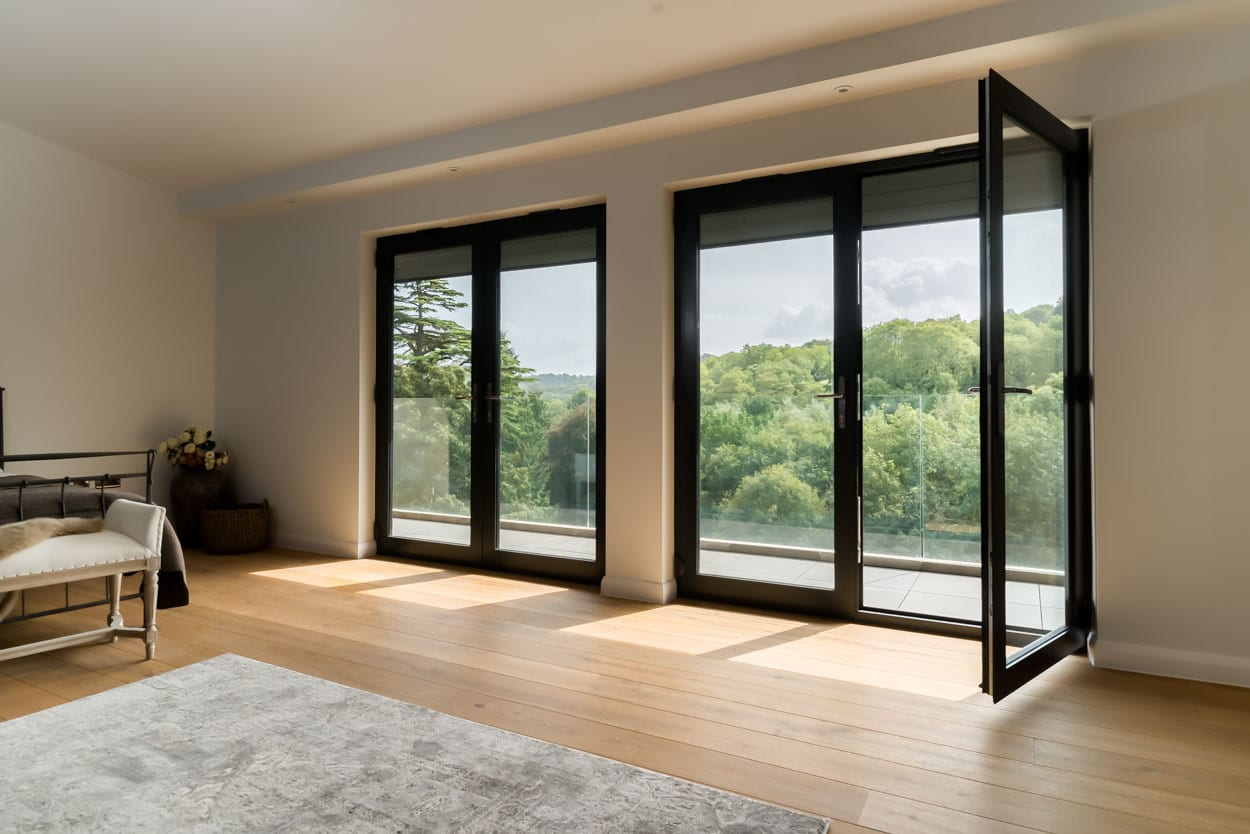 Aluminium French Doors open to show panoramic views