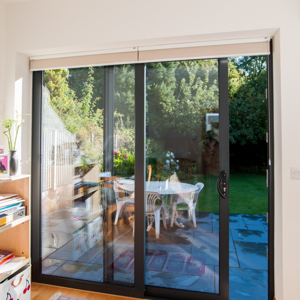Aluminium Sliding Patio Doors open out to a garden