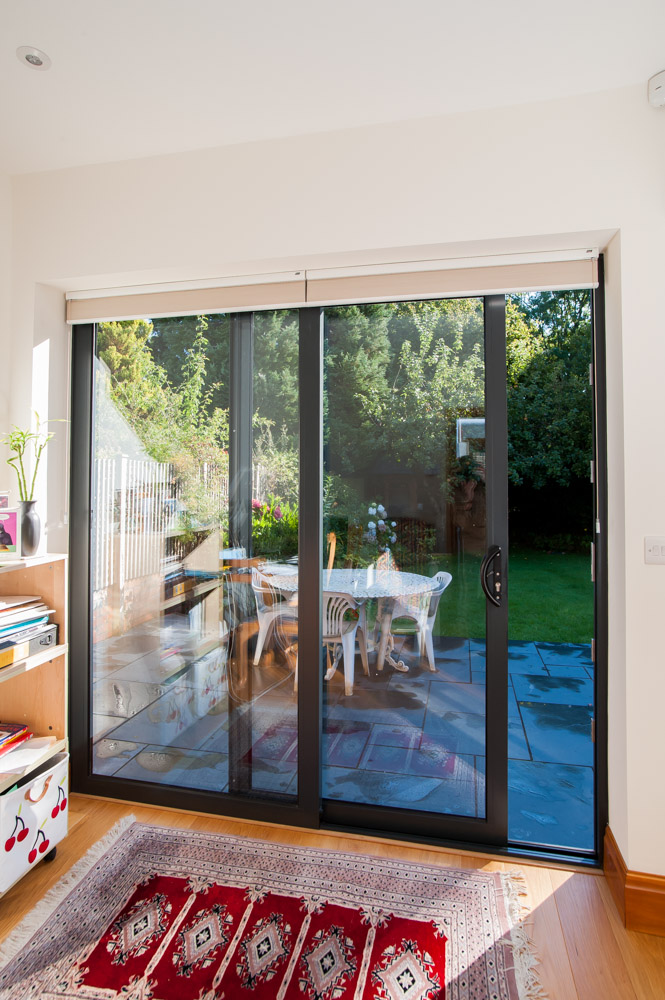 Aluminium Sliding Patio Doors open out to a garden