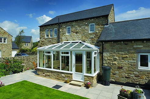 White Conservatory with stone base on stone building